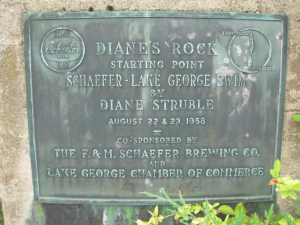 Plaque commemorating Diane Struble's historic swim, placed on Diane's Rock.